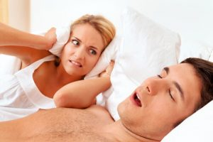 woman angry wants to know how to prevent someone from snoring
