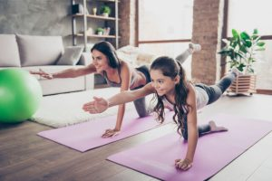 Exercising with her daughter