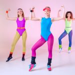 three women wearing aerobic oufits