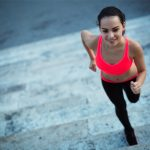 fit woman running on stairs