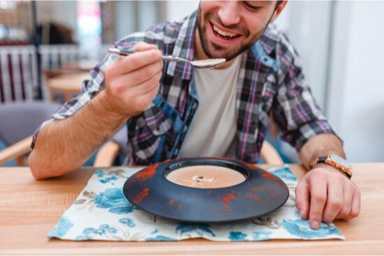 man eating mushroom soup