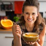 woman eating pumpkin soup