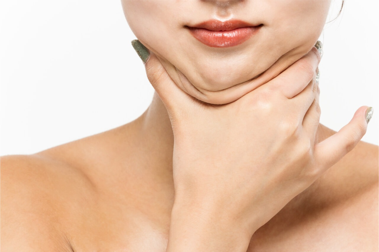 A lady holding her chin fat