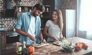 couple preparing their healthy meal for the day