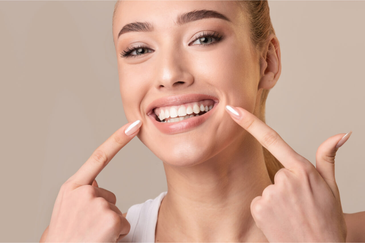 woman pointing teeth