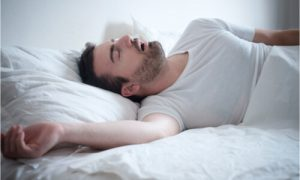 The man falls asleep while thinking about does obesity cause sleep apnea.